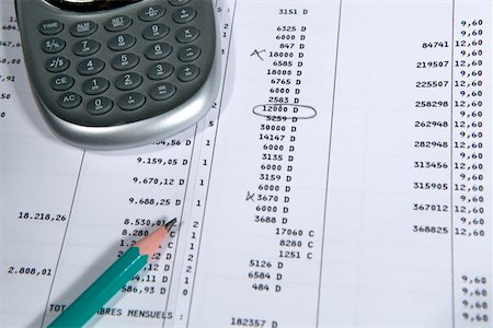 Calculator and pencil on spreadsheet, close up Stock Photo - Premium Royalty-Free, Code: 6106-05506462