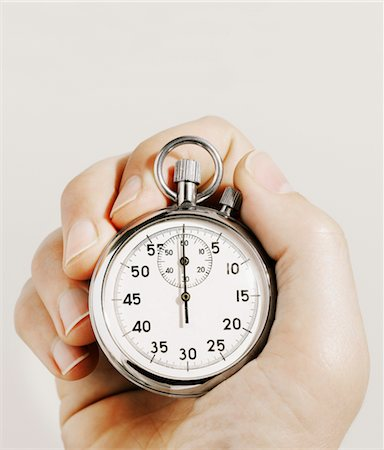 stop watch - Man holding stopwatch, close-up Stock Photo - Premium Royalty-Free, Code: 6106-05507634