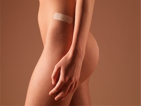 female nude hip - Naked young woman with adhesive bandage on hip, mid section, side view Stock Photo - Premium Royalty-Free, Code: 6106-05508023