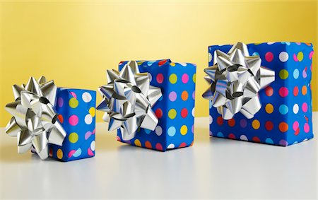 silver box - Three gift boxes with bows Stock Photo - Premium Royalty-Free, Code: 6106-05508270