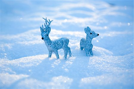 reindeer in snow - Reindeer figurines in snow Stock Photo - Premium Royalty-Free, Code: 6106-05508367