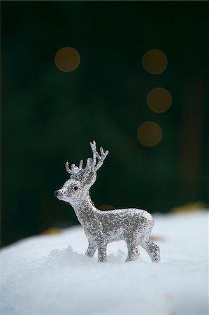 reindeer in snow - Silver reindeer figurine in snow Stock Photo - Premium Royalty-Free, Code: 6106-05508368