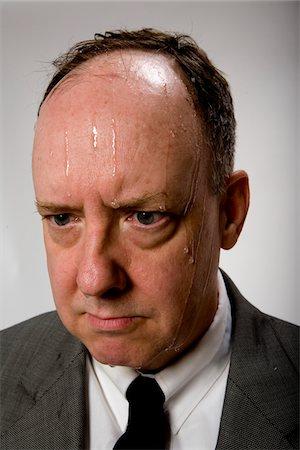 sweaty businessman - Man sweating, studio shot, close-up Stock Photo - Premium Royalty-Free, Code: 6106-05509242