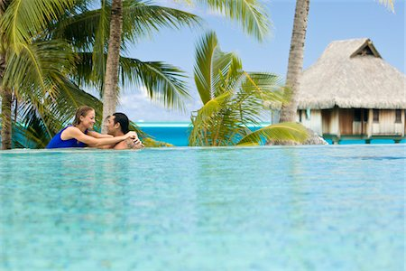 french polynesia - French Polynesia, Bora Bora, Bora Bora Nui Resort, Couple embracing in infinity pool Stock Photo - Premium Royalty-Free, Code: 6106-05509286