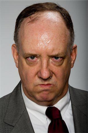 sweaty businessman - Man sweating, portrait Stock Photo - Premium Royalty-Free, Code: 6106-05509238