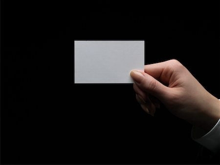 Woman holding blank business card, close-up of hand Stock Photo - Premium Royalty-Free, Code: 6106-05511666