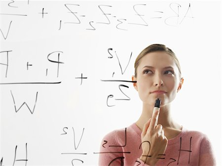 formula - Young woman calculating equations on glass Stock Photo - Premium Royalty-Free, Code: 6106-05512328