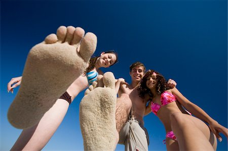 female 16 year old feet - Teenagers (14-17), two holding up sandy feet, portrait, view from below Stock Photo - Premium Royalty-Free, Code: 6106-05524977