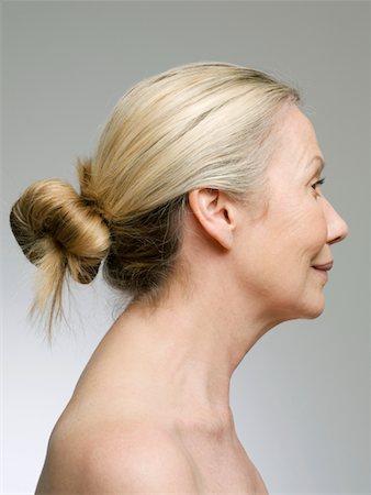 Senior woman with blonde hair in bun, profile Stock Photo - Premium Royalty-Free, Code: 6106-05538580