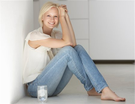 drinking water glass - Women sitting beside glas of water Stock Photo - Premium Royalty-Free, Code: 6106-05603152