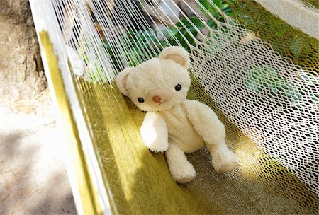 Teddy bear on hammock Stock Photo - Premium Royalty-Free, Code: 6106-05603212