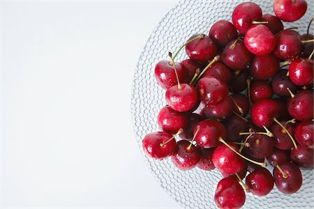 The cherry on the glass plate. Stock Photo - Premium Royalty-Free, Code: 6106-05603219