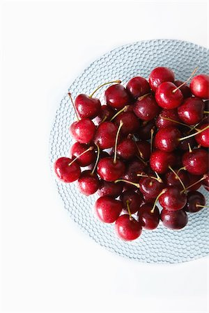 The cherry on the glass plate. Stock Photo - Premium Royalty-Free, Code: 6106-05603233