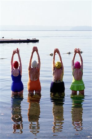 seniors woman in swimsuit - Four Women Stretching in a Lake Stock Photo - Premium Royalty-Free, Code: 6106-05624276