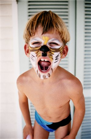 Boy with His Face Painted Stock Photo - Premium Royalty-Free, Code: 6106-05625096