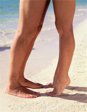 Couple kissing on beach, close-up of feet (low section) Stock Photo - Premium Royalty-Free, Code: 6106-05634496
