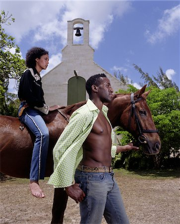 Man leading woman on horse Stock Photo - Premium Royalty-Free, Code: 6106-05634651