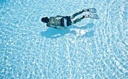 santorini - 1 person diving in swimming pool Stock Photo - Premium Royalty-Free, Code: 6106-05758742
