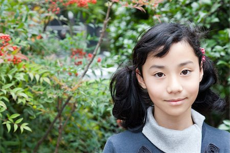 preteen girl - Archaic smile of a Japanese girl Stock Photo - Premium Royalty-Free, Code: 6106-05758715