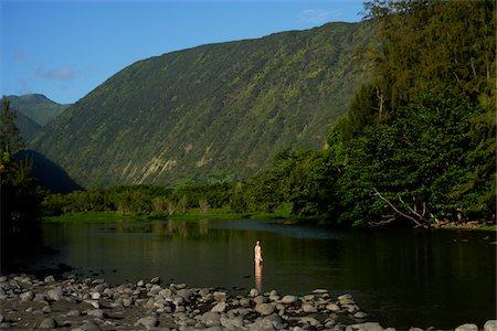 One girl standing in Waipio River. Stock Photo - Premium Royalty-Free, Code: 6106-05758889