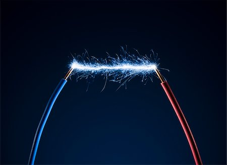 spark - Electric current sparking between two cables Stock Photo - Premium Royalty-Free, Code: 6106-05759060