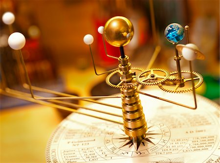 Planets orbit the sun on an Orrery. Stock Photo - Premium Royalty-Free, Code: 6106-05759278