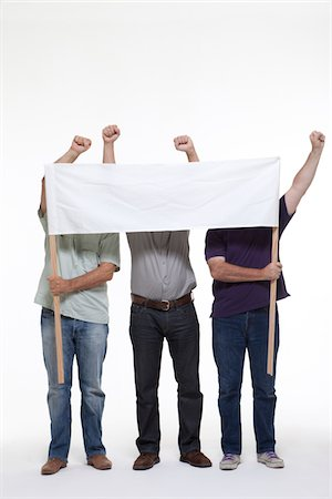 3 protesters behind a banner Stock Photo - Premium Royalty-Free, Code: 6106-05787293