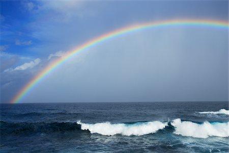 rainbow - Rainbow appearing over the horizon. Stock Photo - Premium Royalty-Free, Code: 6106-05787514