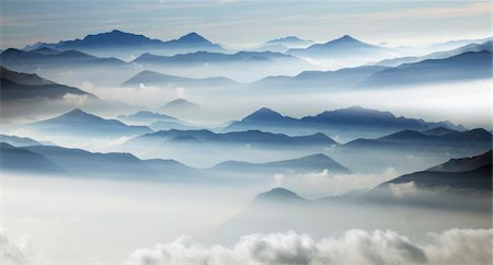 fog (weather) - Swiss Alps in the morning fog Stock Photo - Premium Royalty-Free, Code: 6106-05787917