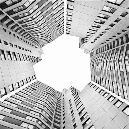 High-rise buildings forming geometrical shapes Stock Photo - Premium Royalty-Free, Code: 6106-05788088