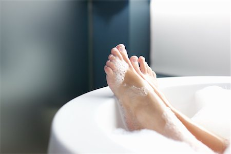 Feet of woman relaxing in bubble bath Stock Photo - Premium Royalty-Free, Code: 6106-05788174
