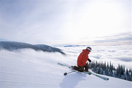 Telemark skier skis freshly groomed ski trail Stock Photo - Premium Royalty-Free, Code: 6106-05788209