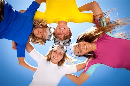 preteen long hair - Young kids smiling in the sun with snorkel goggles Stock Photo - Premium Royalty-Free, Code: 6106-05788432
