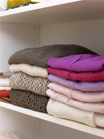 Sweaters and knit wear on closet shelf. Stock Photo - Premium Royalty-Free, Code: 6106-05810544