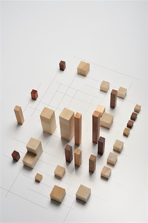 Small pieces of wood arranged like building Stock Photo - Premium Royalty-Free, Code: 6106-05810530