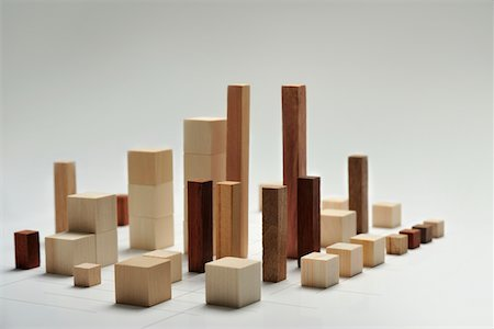 Small pieces of wood arranged like building Stock Photo - Premium Royalty-Free, Code: 6106-05810536