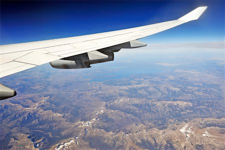 Airplane wing over Wyoming mountains Stock Photo - Premium Royalty-Free, Code: 6106-05951471