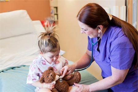Nurse taking care of toddler girl in hospital. Stock Photo - Premium Royalty-Free, Code: 6106-05951421