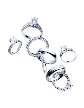 expensive jewelry - Diamond rings linked Stock Photo - Premium Royalty-Free, Code: 6106-05951948