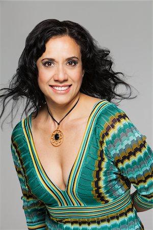 Smiling portrait of hispanic woman Stock Photo - Premium Royalty-Free, Code: 6106-05951962