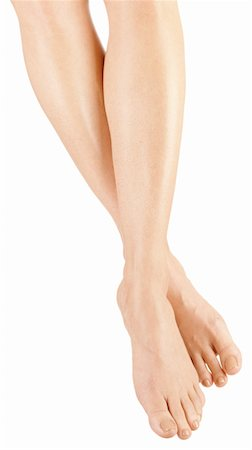Beautiful woman's legs crossed at ankle Stock Photo - Premium Royalty-Free, Code: 6106-05952121