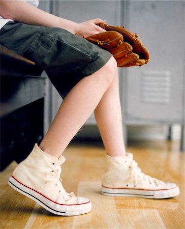 boy legs with tennis shoes holding baseball mitt Stock Photo - Premium Royalty-Free, Code: 6106-05952289