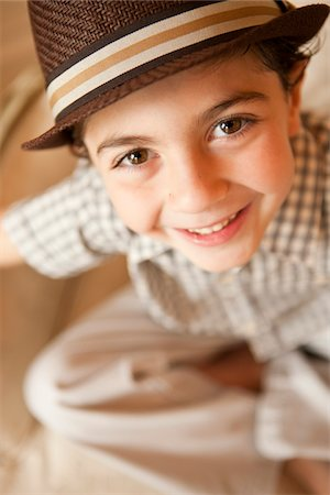 elementary age - Boy with Hat Stock Photo - Premium Royalty-Free, Code: 6106-05952343
