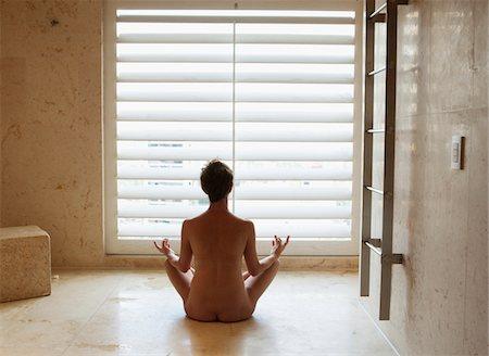 Woman doing yoga naked Stock Photo - Premium Royalty-Free, Code: 6106-05977947