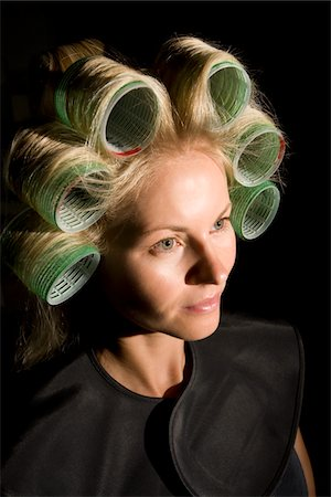 portrait of woman in hair rollers Stock Photo - Premium Royalty-Free, Code: 6106-05978244