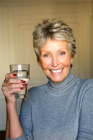 drinking water glass - Mature woman with glass of water Stock Photo - Premium Royalty-Free, Code: 6106-05978594