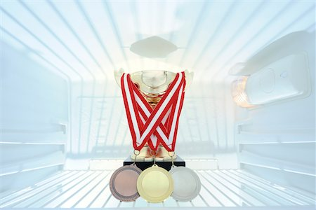 Golden trophy and medals in refrigerator Stock Photo - Premium Royalty-Free, Code: 6106-05978628