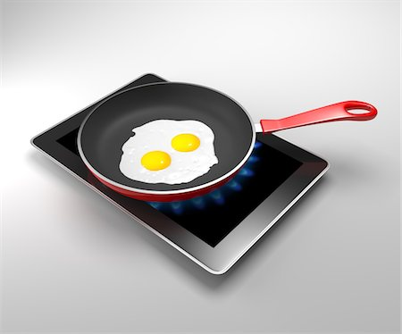 Fired egg and pan on a digital tablet Stock Photo - Premium Royalty-Free, Code: 6106-06042919