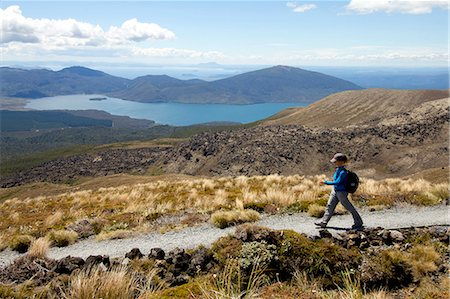 Woman hiking Tongariro Alpine Crossing Stock Photo - Premium Royalty-Free, Code: 6106-06114363