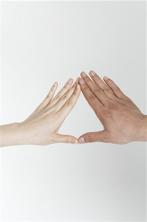 shape - Man and woman touching hands Stock Photo - Premium Royalty-Free, Code: 6106-06114332